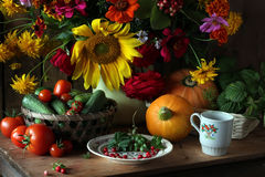 Still life with a bouquet of cultivated flowers stock image