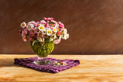 Still life bouquet daisies wooden table Royalty Free Stock Images