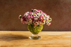 Still life bouquet daisies wooden table Royalty Free Stock Photo