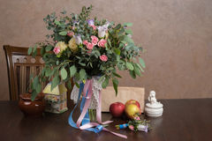 Still-life with a bouquet of flowers. And apples Stock Images