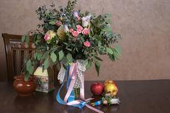 Still-life with a bouquet of flowers. And apples Royalty Free Stock Images