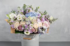 Still life with a bouquet of flowers. the florist put together a beautiful bunch of flowers. Man manual work used Royalty Free Stock Photography