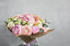 Still life with a bouquet of flowers. the florist put together a beautiful bunch of flowers. Man manual work used Stock Photo