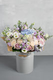 Still life with a bouquet of flowers. the florist put together a beautiful bunch of flowers. Man manual work used Royalty Free Stock Photos