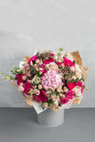 Still life with a bouquet of flowers. the florist put together a beautiful bunch of flowers. Man manual work used Royalty Free Stock Images