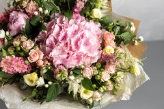 Still life with a bouquet of flowers. the florist put together a beautiful bunch of flowers. Man manual work used Royalty Free Stock Image