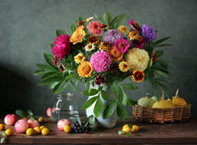 Still life with bouquet and fruits. stock photos