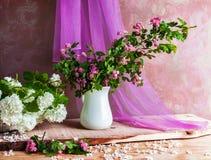 Still Life bouquet hawthorn viburnum twigs flowers Stock Image