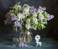 Still life with bouquet of lilac in a vase. And candy Royalty Free Stock Photography