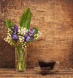 Still-life bouquet of lily. Of the valley  with blue irises Royalty Free Stock Photo