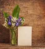 Still-life bouquet of lily. Of the valley  with blue irises Stock Photography