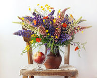 Still life bouquet with lupine and buttercups in the jug on the royalty free stock photos