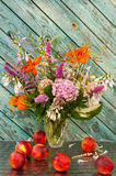 Still life bouquet with nectarines Stock Photos