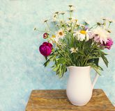 Still life with bouquet of summer flowers in a jar Royalty Free Stock Photo