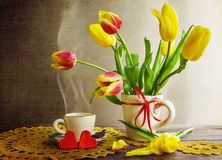 Still life bouquet tulips cup coffee stock image