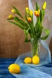 Still life bouquet tulips lemons royalty free stock image
