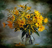 Still life with bouquet of yellow flowers Stock Photos