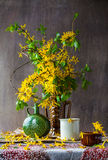 Still Life bouquet yellow forsythia spring. Still Life with a bouquet of yellow forsythia spring Stock Images