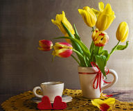 Still life bouquet yellow tulips hearts Royalty Free Stock Photos