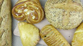 Still life of bread baking. And sweet buns, food background closeup Stock Photos
