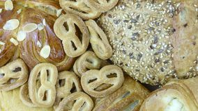Still life of bread baking. And sweet buns, food background closeup Stock Images