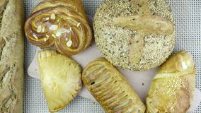 Still life of bread baking. And sweet buns, food background closeup Royalty Free Stock Photo