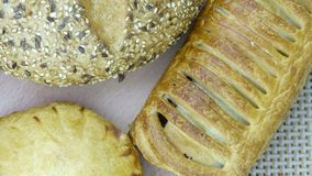 Still life of bread baking. And sweet buns, food background closeup Royalty Free Stock Image