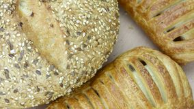 Still life of bread baking. And sweet buns, food background closeup Royalty Free Stock Photos
