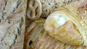 Still life of bread baking. And sweet buns, food background closeup Royalty Free Stock Photography