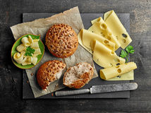 Still life with bread and cheese. On wooden table, top view Royalty Free Stock Images