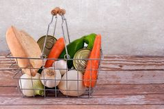 Shopping basket with vegetables, bread and preserves. Still life with bread, garlic, peppers,carrots, onions and preserves Stock Images