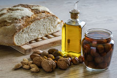 Still life with bread, olive oil, nuts. and cherries in liqueur Royalty Free Stock Photos