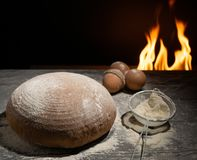 Still life bread from the oven on the table with flour. stock photo
