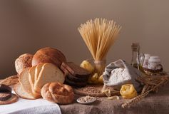 Still life. With bread, pasta and wheat Stock Images