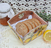 Still life with bread. The bread is in a wooden bread bins stock photos