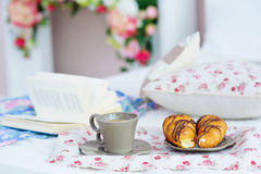 Still life with breakfast and book in bed Royalty Free Stock Photo