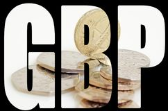 British pound and pence. Still-life with the British pound and pence Royalty Free Stock Photography
