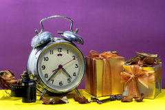 Still life with broken alarm clock, camera film, vintage key, de Stock Photo
