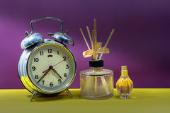 Still life with broken alarm clock, empty essential oil, classic Royalty Free Stock Images