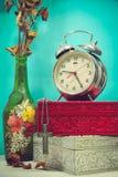Still life with broken alarm clock, metal cross with metal neckl Stock Images