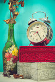 Still life with broken alarm clock, metal cross with metal neckl Royalty Free Stock Image