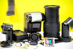 Still life with broken camera lens, flash, camera film, Cmos sen Royalty Free Stock Image