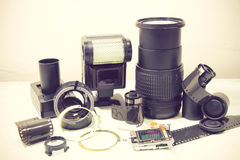 Still life with broken camera lens, flash, camera film, Cmos sen Stock Photos