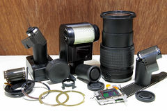 Still life with broken camera lens, flash, camera film, Cmos sen Stock Photography