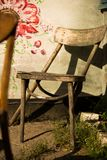 Still-life with the broken vintage chair Stock Photos