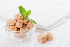 Still life with brown lump cane sugar Royalty Free Stock Image