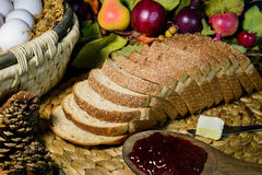 Still life brown whole grain bread and jam Royalty Free Stock Photography