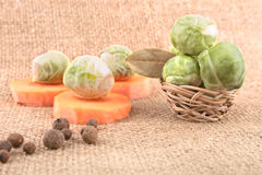 Still life with Brussels sprout, carrot and spices Stock Photos