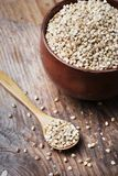Still life with buckwheat grain heap in wooden bowl on vintage stock photos
