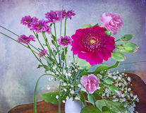 Still life, bunch of spring flowers on grunge background Stock Photos